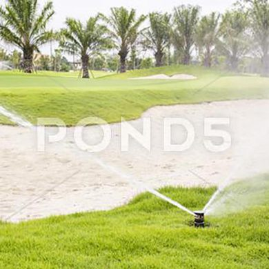054297183-sprinkler-watering-golf-course